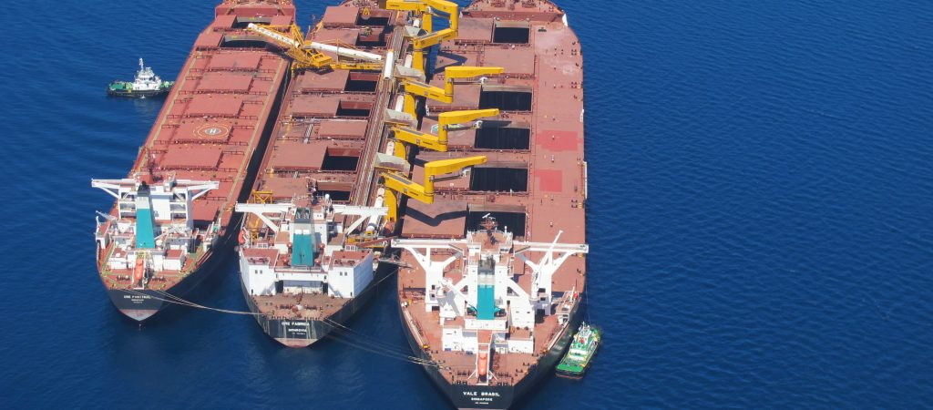 Conversion from ore carrier into transhipper